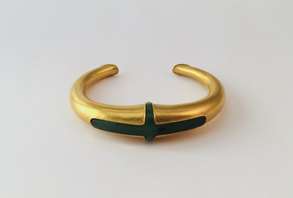 Bangle, 1973. Gold 900, hollow driven, with Jade cross. Photo Richard Beer.