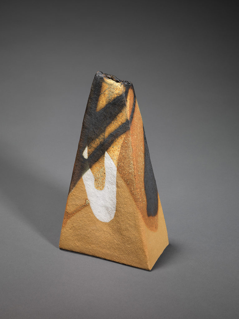 "Ascending shape with a ""crumbling"" finish. Manganese ore, kaolin, copper carbonate, apple tree ash, H 28, W 15, D 8.6 cm."