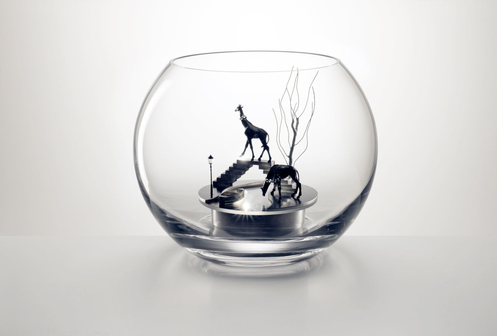 <em>Neuland</em> object. Glass, stainless steel, wire, faceted crystal glass stones, miniature lantern, miniature figures. H 12 cm ø 23 cm