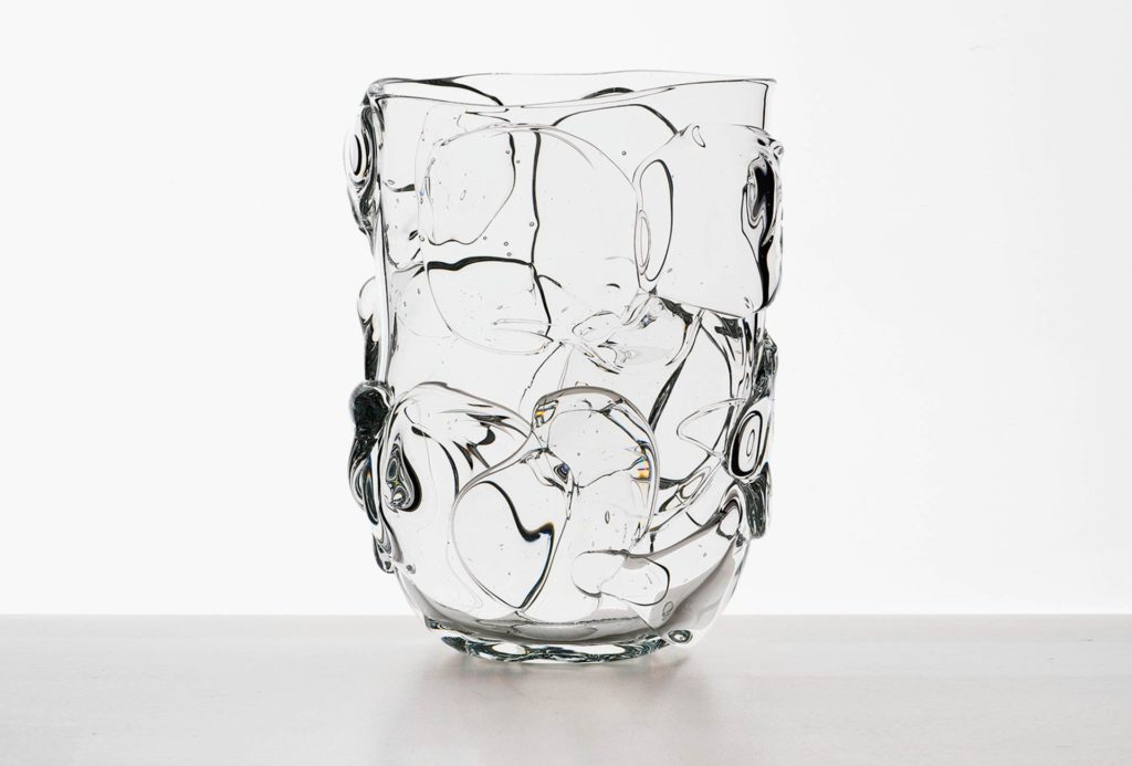 Vase. Flat oval pressed shape, crystal, free mounted elements, H 30.5cm.